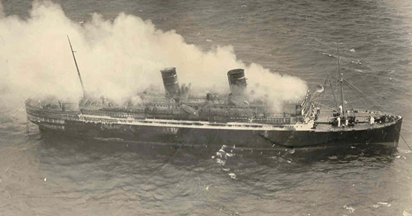 The luxury cruise ship SS Morro Castle burning at sea in 1934
