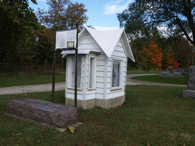 The dollhouse grave of Lova Cline in Arlington, Indiana
