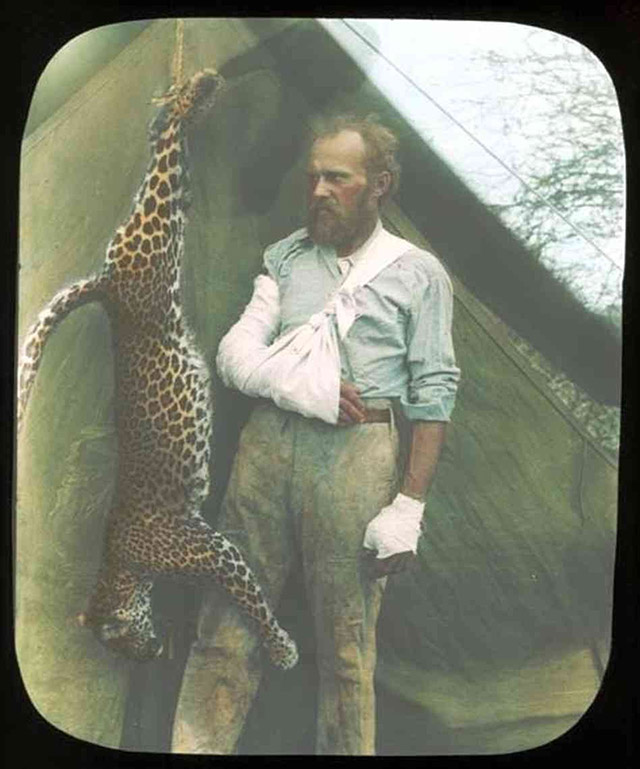 Legendary taxidermist Carl Akeley stands with the leopard he killed with his bare hands