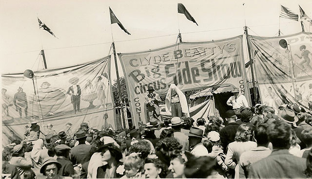 Vintage photos of a crowd gathered for Clyde Beatty's circus sideshow