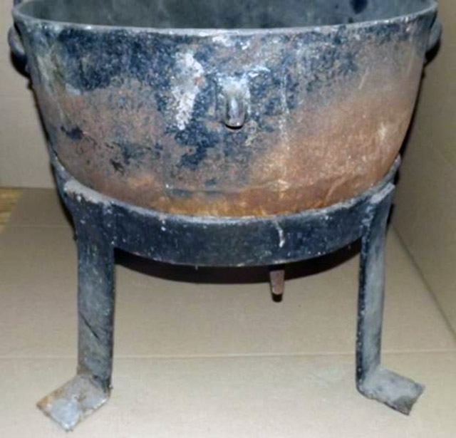 An antique cauldron found covered in blood at the Ed Gein crime scene in Plainfield, WI
