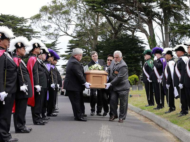 The Knights of Columbus carry the coffin of a girl who died 145 years ago