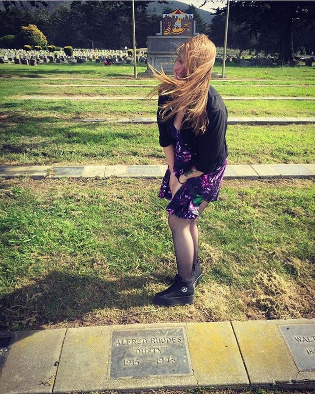 Laura Hardin at the grave of