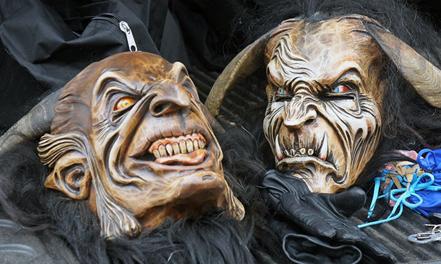 Wood-carved Krampus masks