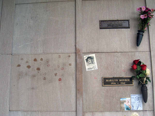 The grave of Richard Poncher above Marilyn Monroe
