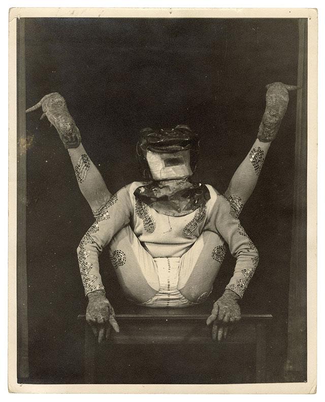 Contortionist in a bizarre costume